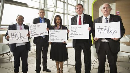 Councillors and Newham mayor Sir Robin Wales make their pledge against domestic violence