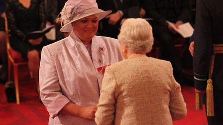 Natasha Hart collects her MBE award from HM the Queen. Picture: Yui Mok/PA Images