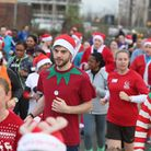 Participants join the Festive Run dressed as Santas at the Queen Elizabeth Olympic Park, Stratford.