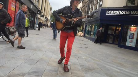 Busker Jonny Walker was moved on from Romford town centre by a police officer and banned from the to