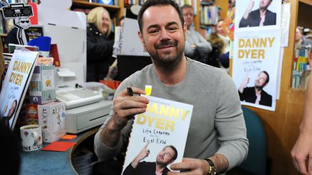Actor Danny Dyer signing copies of his book at the Newham Bookshop