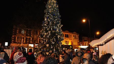 Crowds gather to watch the Christmas tree be switched on