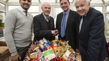 Stratford resident Arthur Francis receives his hamper from Cllr Mas Patel, Sir Robin Wales and Cllr