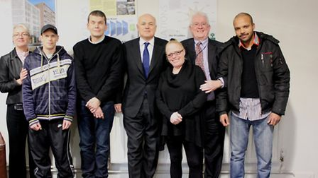 Iain Duncan Smith with staff and residents at Caritas Anchor House