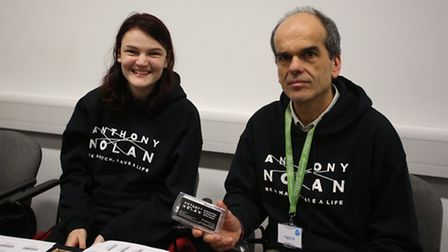 Lara's father, Dr Stefano Casalotti, with student volunteer Kerry Lawrence and a testing kit