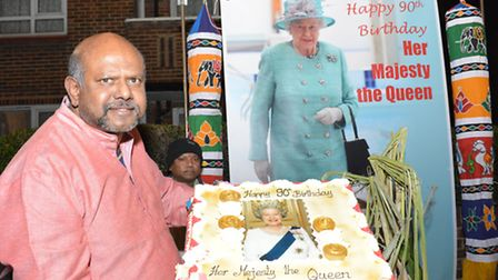 Cllr Paul Sathianesan poses with birthday cake for the Queen at Pongal 2016