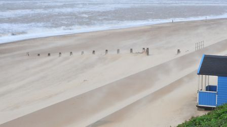 Sand is blown off the beach earlier this week at Southwold during the high winds that have battered
