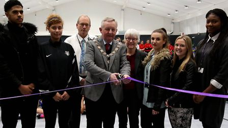 The opening of the new sports hall at Barking Abbey School. The Mayor cutting the ribbon with cllr E