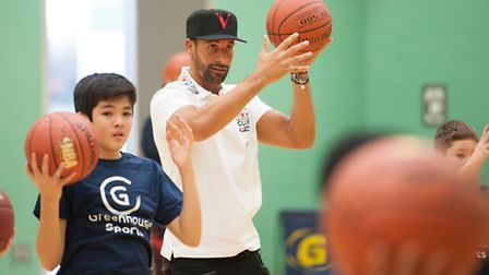Rio Ferdinand plays basketball with students at Cumberland School (picture: C1 Photography)
