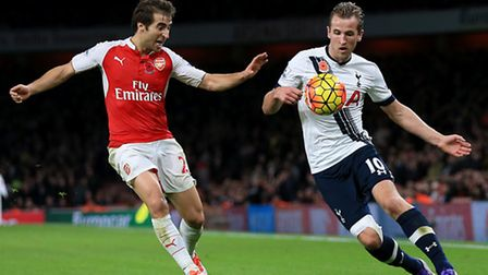 Arsenal's Mathieu Flamini battles for the ball with Tottenham Hotspur's Harry Kane at the Emirates S