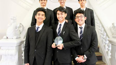The Newham Collegiate Sixth Formers with their trophy