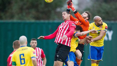 Harry Palmer of Witham Town punches clear from Leon McKenzie of Hornchurch (pic: Ray Lawrence/TGSPHO