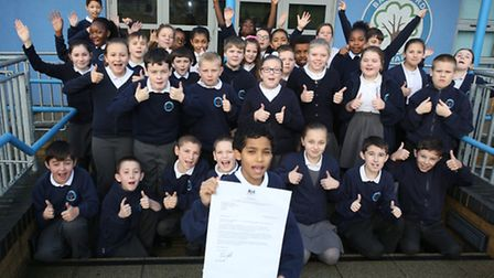 Pupils outside Broadford Primary School which has been ranked in the top 100 in the country for the