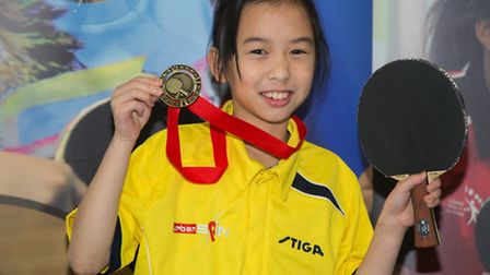 Sophie Chang shows off her medal after winning the Jack Petchey Foundation London Schools Singles gi