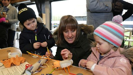 Joshua, 5, and Izzy, 3, make models out of recycled material with their mother Liz Span