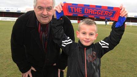 Olly Mummery who has autism, enjoying being at his first football match with Frank Bishop