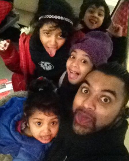 Mr Aziz, with his four children, who he had just dropped off prior to the road collision