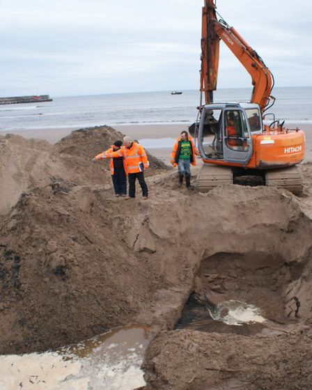 Jon Hill and his team search for the body of Peter Wilson on Waterfoot Beach, County Antrim. Photo: