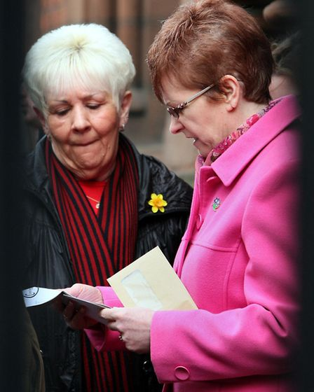 Anne Connolly (right), sister of Peter Wilson, with other family members, leave an inquest into his