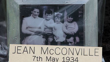 A photograph is left as a tribute as the family of IRA murder victim Jean McConville plant a tree to