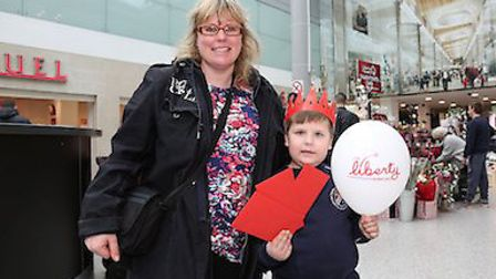 Vinnie Bailey, six, with his mum after scooping a £20 gift card at the Liberty Shopping Centre's Val
