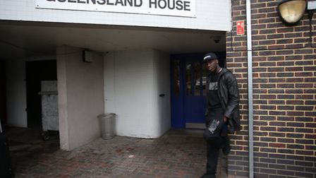 Up and coming Grime Artist Quincy Oyenuga outside the Queensland House flats where he grew up
