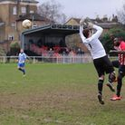Clapton's Tony Cookey heads over Hullbridge Sports goalkeeper for his second of the afternoon (pic: