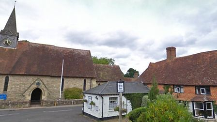 Ye Olde Sun Inn, right and Holy Trinity Church, left in Plaistow, West Sussex Picture: Goog