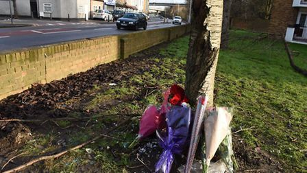 Floral tributes lie at the scene of a car crash on Chigwell Road which resulted in the death of a wo