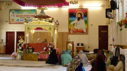 Women gathered at the gurdwara in Manor Park for worship and free food Picture: Dharam Sahdev