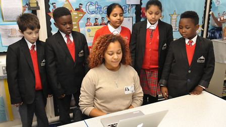 Community engagement manager Sade Banks with pupils