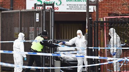 Police and forensic officers at Direct Source 3 Ltd warehouse on Rea Street South where Mr Javeed w