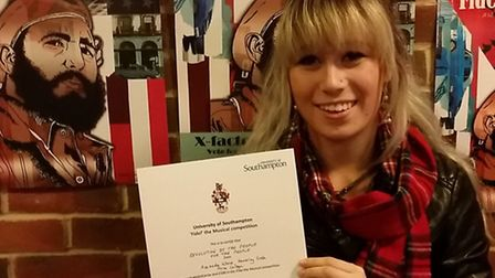 Amanda with her certificate