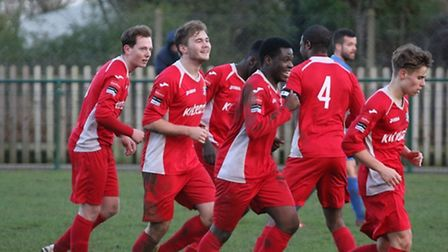 Redbridge players celebrate after Charlie Portway (left) netted a late winner at Wroxham (pic: Phili