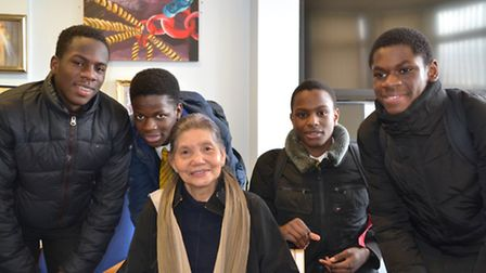 Zenaida Cabrera, centre, with the St Bonaventure's students who helped her