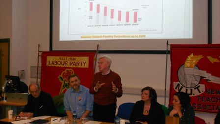 Labour shadow chancellor John McDonnell, standing, and West Ham MP Lyn Brown, second right, at the a