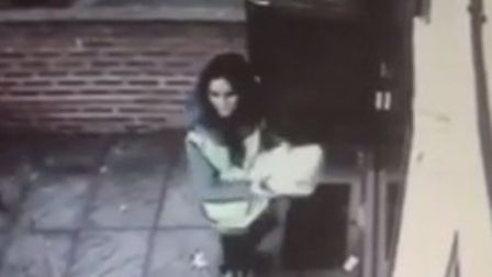 The woman is described as white with dark brown/black hair, in her early 20s and with Eastern Europe
