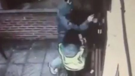 The first attacker wrestles with Mr Walia at his front door before forcing his way in