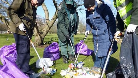 Volunteers and staff check the bins at West Ham Park
