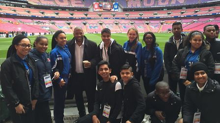 Oaks Park pupils got to meet John Barnes while working as ball boys and girls at the Capital One Cup