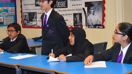 Debaters from Stratford School Academy argue a motion