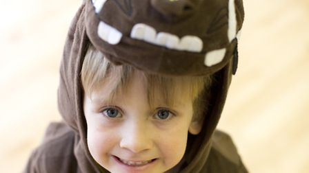 Sam Swallow, from Forest School, Snaresbrook, dresses up as book character The Gruffalo.Photo: Isa