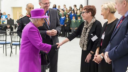 The Queen with Anthony Wilson, head of Lister Community School being intoruced to Charlotte Robinson