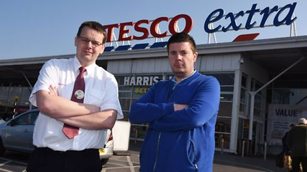 Tesco secuity staff Neil Connelly and his manager Andy Stringer in front of the store in Hornchurch