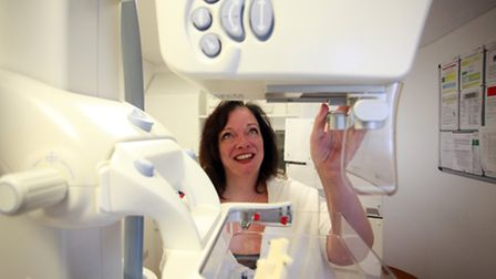Lyn Brown MP looks at a mammography machine at St. Barts Hospital.