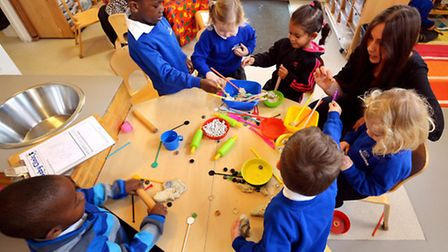 A teacher and children at a nursery, nationally less than half of nurseries are likely to offer the