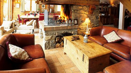 Cosy sofas by the fire in the chalet-hotel Au Coin Du Feu