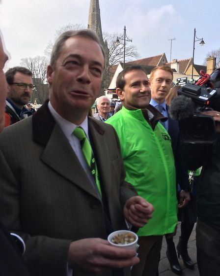 Nigel Farage enjoying some whelks from a fish stall