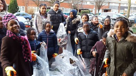 Youngsters from the Asta Community Hubs Play Project engaged in a litter pick in partnership with Cl