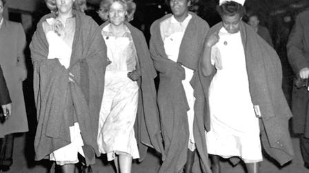 After toiling all night among the injured of the railway crash, these four nurses came up from the t
